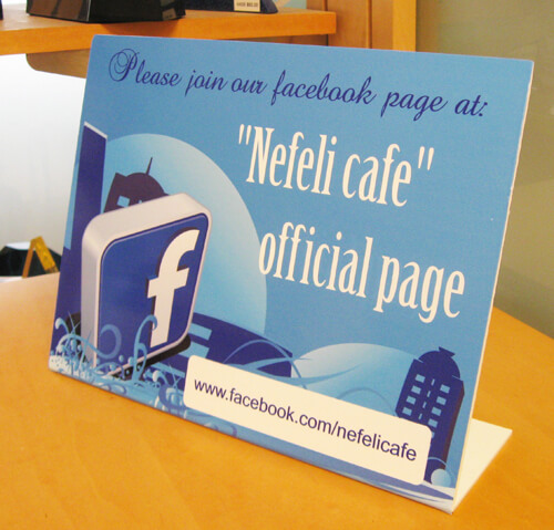 "8.5"" x 11"" Facebook Bent Sign on table top"