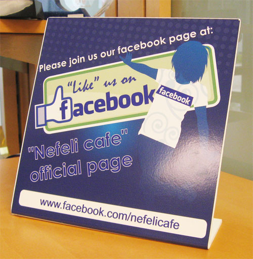 "8"" x 8"" Facebook Bent Sign on table top"