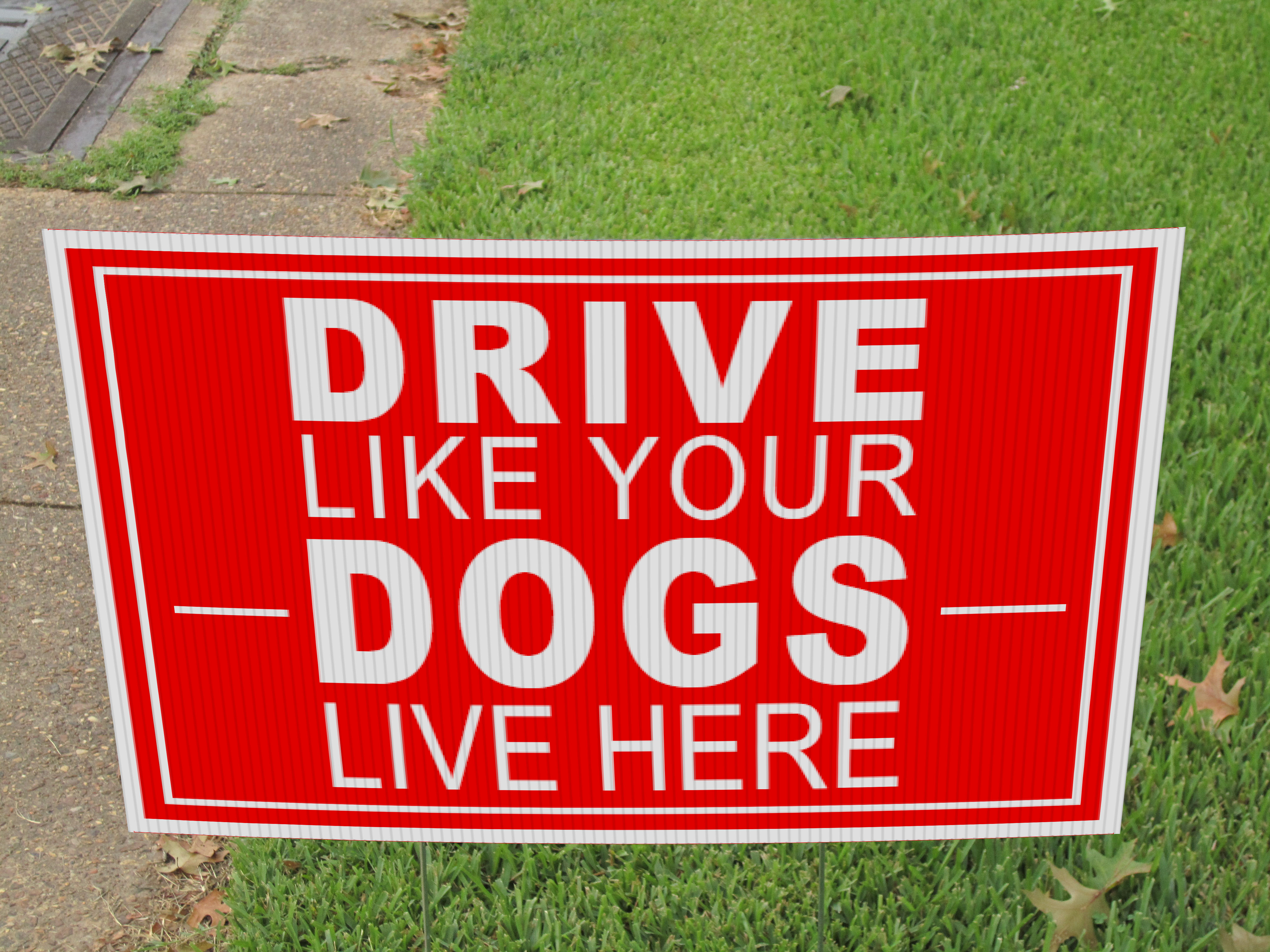 Drive Like Your Dogs Live Here Yard Sign